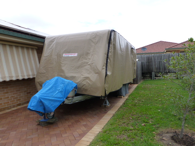 The Caravan wrapped up in its storm cover - what you have when you can't have a shed