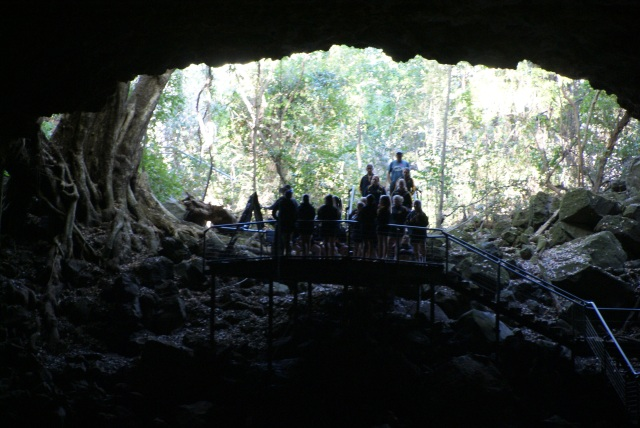 A group of students at the mouth of the lava tube