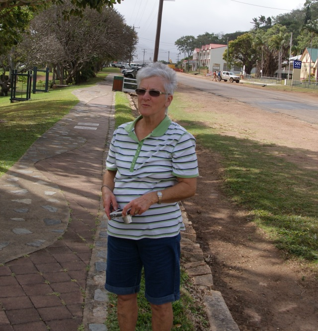 Margaret in a windy Cooktown Street