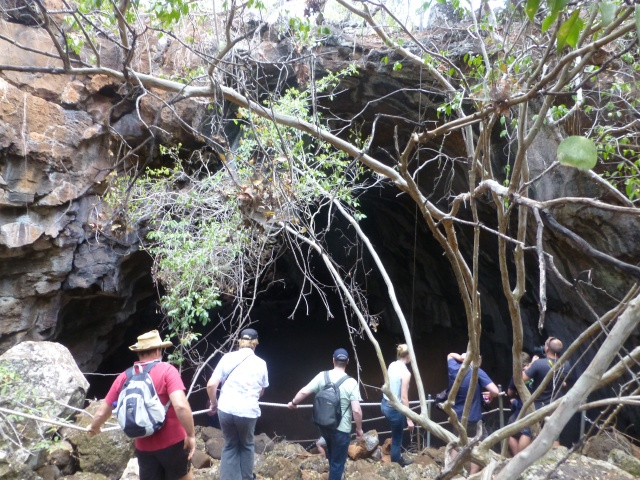Climbing over the rocks to a lava tube