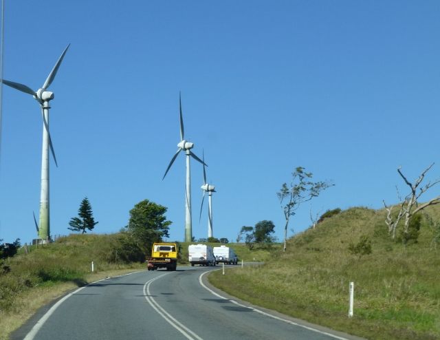 The turbines loom large as you drive past