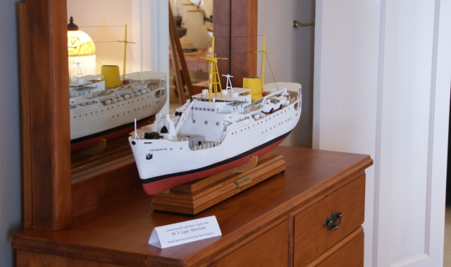 A model of the lighthouse supply vessel MV Cape Moreton on display inside the cottage