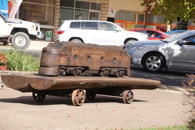 Wooden engine sculpture in main street
