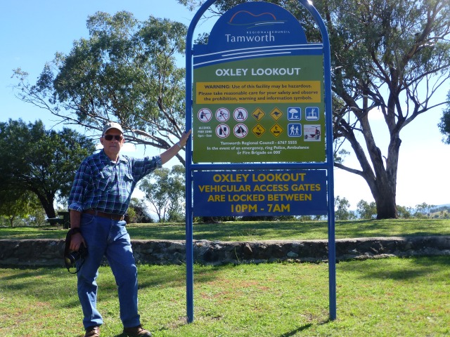 Some fool leaning on the sign at Oxley Lookout
