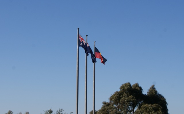 Flags flying outside the Gold Museum
