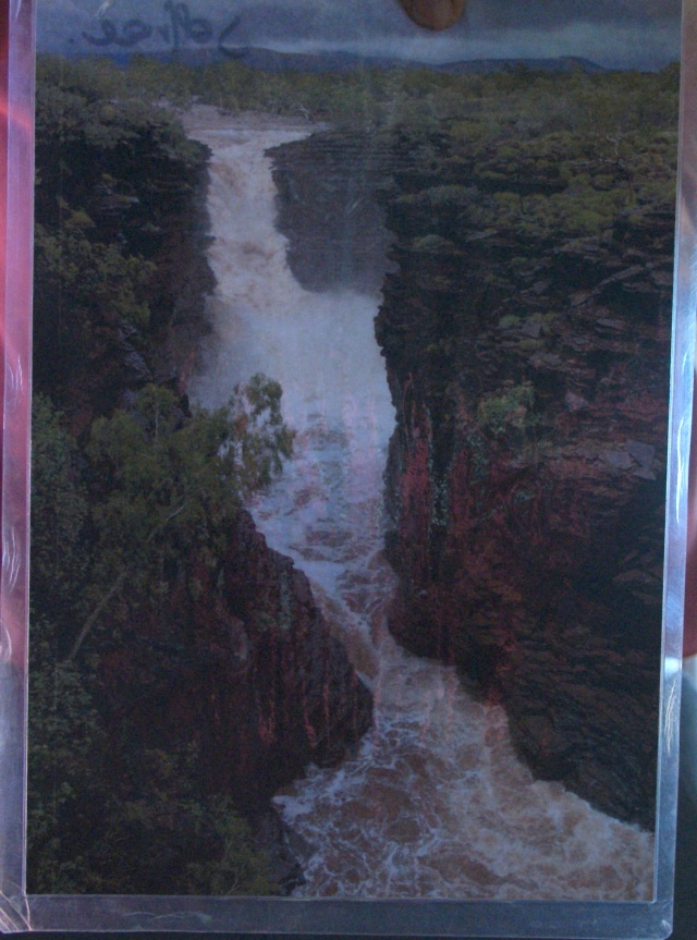 A picture of a picture of Joffre Falls in flood