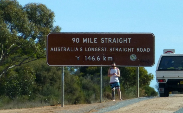 The 90 Mile Straight Sign - Pity about the Model? Had to check his mobile.