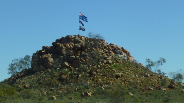 These flags appear on this hill in the middle of nowhere south of Port Hedland - note the Jolly Roger is there too