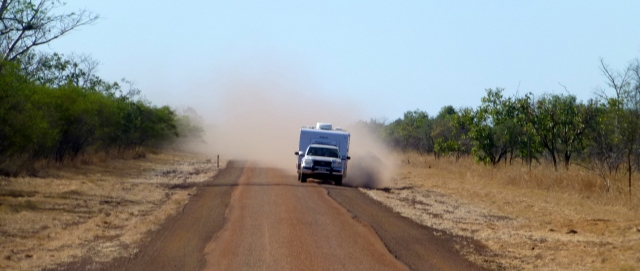 Another caravan passes the bus on the Gibb River Road