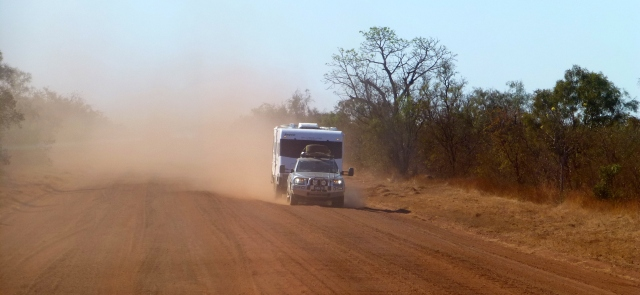 A caravan appears from the dust on the road to Windjana Gorge