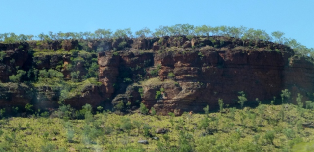 Towering cliffs above the road near Victoria River Roadhouse