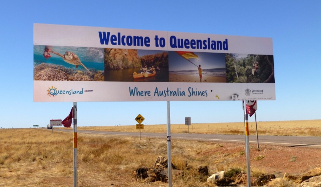 Welcome to Queensland - State of Origin Flags flying on the posts