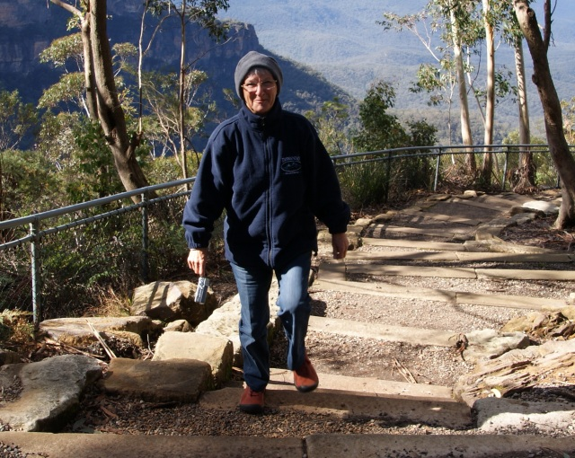 Margaret happy to reach the top of the track to a lookout in the Blue Mountains